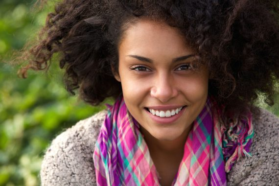Attractive-african-american-woman-smiling-outdoors