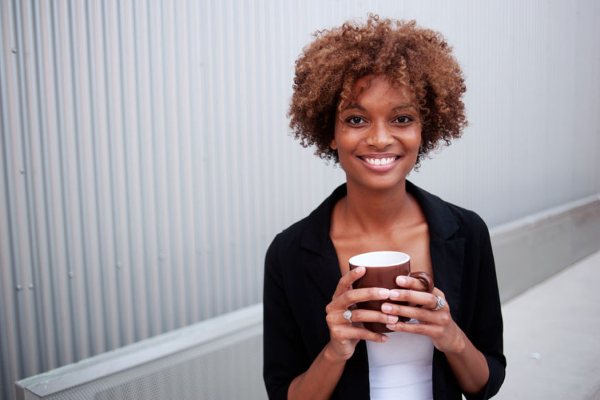 curly-hair-holding-coffee
